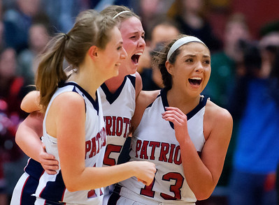 AUGUSTA, Maine -- 03/03/2017 -- Gray-New Gloucester celebrates after defeating Houlton during their Class B girls basketball state championship at the Augusta Civic Center in Augusta Friday. Ashley L. Conti | BDN