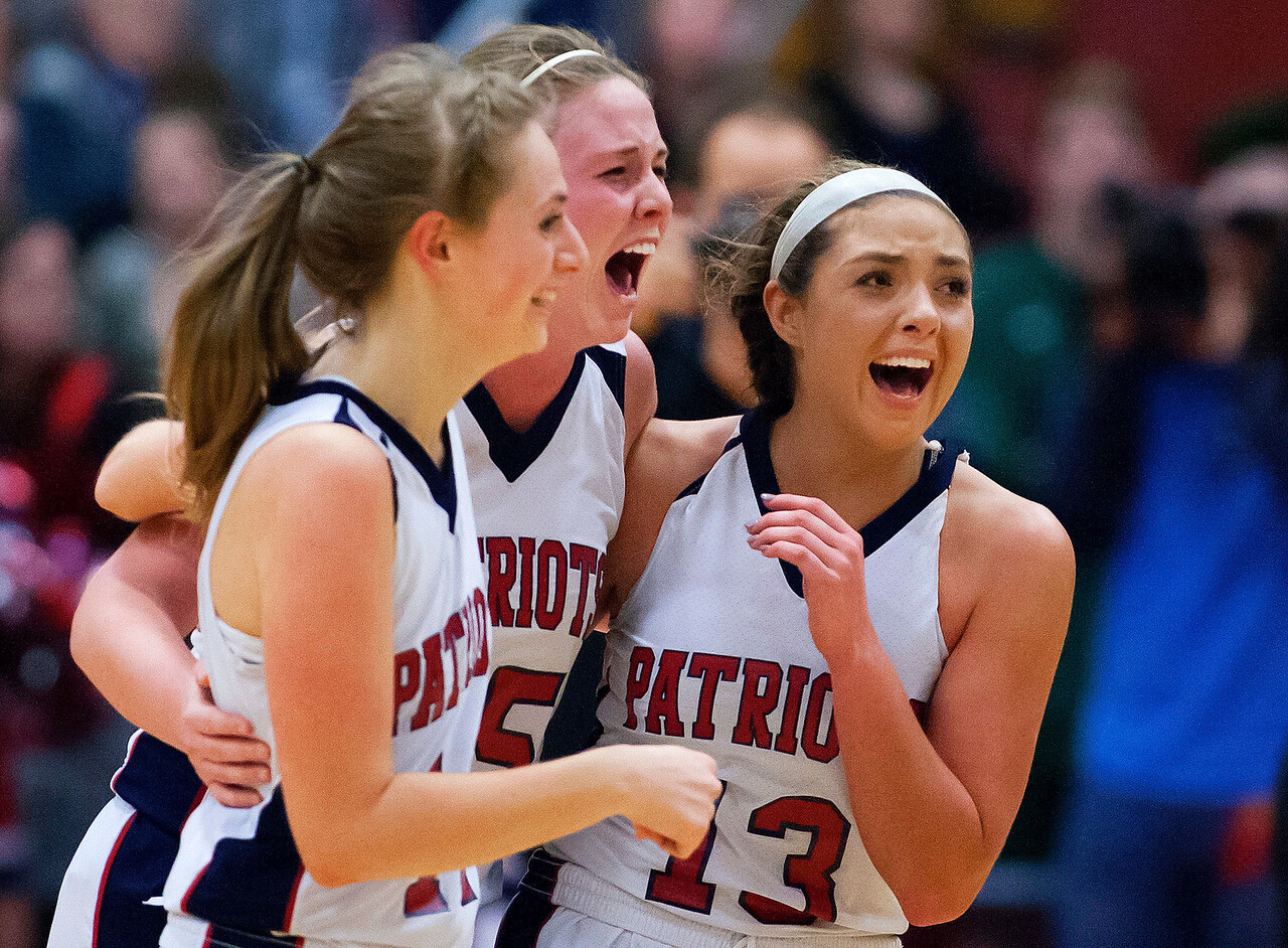 AUGUSTA, Maine -- 03/03/2017 -- Gray-New Gloucester celebrates after defeating Houlton during their Class B girls basketball state championship at the Augusta Civic Center in Augusta Friday. Ashley L. Conti   BDN
