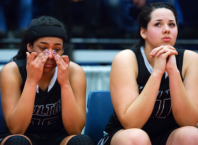 AUGUSTA, Maine -- 03/03/2017 -- Houlton's Tessa Solomon (left) wipes tears from her eyes while teammate Houlton's Makala Watson stares off after being defeated by Gray-New Gloucester during their Class B girls basketball state championship at the Augusta Civic Center in Augusta Friday. Ashley L. Conti | BDN