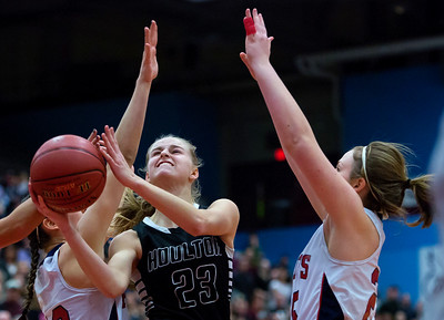 AUGUSTA, Maine -- 03/03/2017 -- Houlton's Kolleen Bouchard (center) tries for two past Gray-New Gloucester's Brianna Jordan (left) and Gray-New Gloucester's Skye Conley during their Class B girls basketball state championship at the Augusta Civic Center in Augusta Friday. Ashley L. Conti | BDN