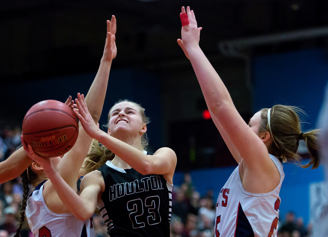 AUGUSTA, Maine -- 03/03/2017 -- Houlton's Kolleen Bouchard (center) tries for two past Gray-New Gloucester's Brianna Jordan (left) and Gray-New Gloucester's Skye Conley during their Class B girls basketball state championship at the Augusta Civic Center in Augusta Friday. Ashley L. Conti   BDN