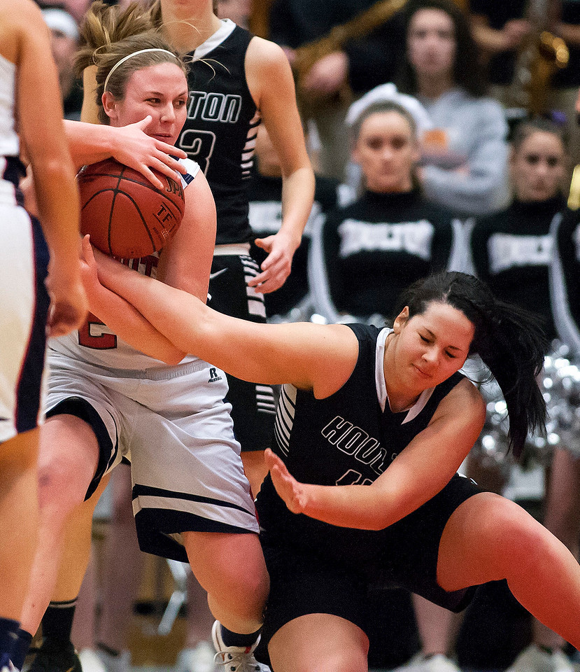 AUGUSTA, Maine -- 03/03/2017 -- Gray-New Gloucester's Skye Conley (left) battles for a loose ball against Houlton's Makala Watson during their Class B girls basketball state championship at the Augusta Civic Center in Augusta Friday. Ashley L. Conti | BDN