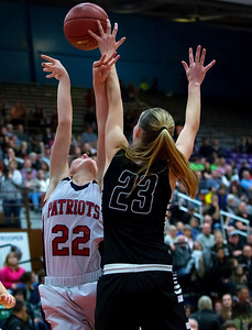AUGUSTA, Maine -- 03/03/2017 -- Gray-New Gloucester's Jordan Grant (left) has her shot blocked by Houlton's Kolleen Bouchard during their Class B girls basketball state championship at the Augusta Civic Center in Augusta Friday. Ashley L. Conti | BDN