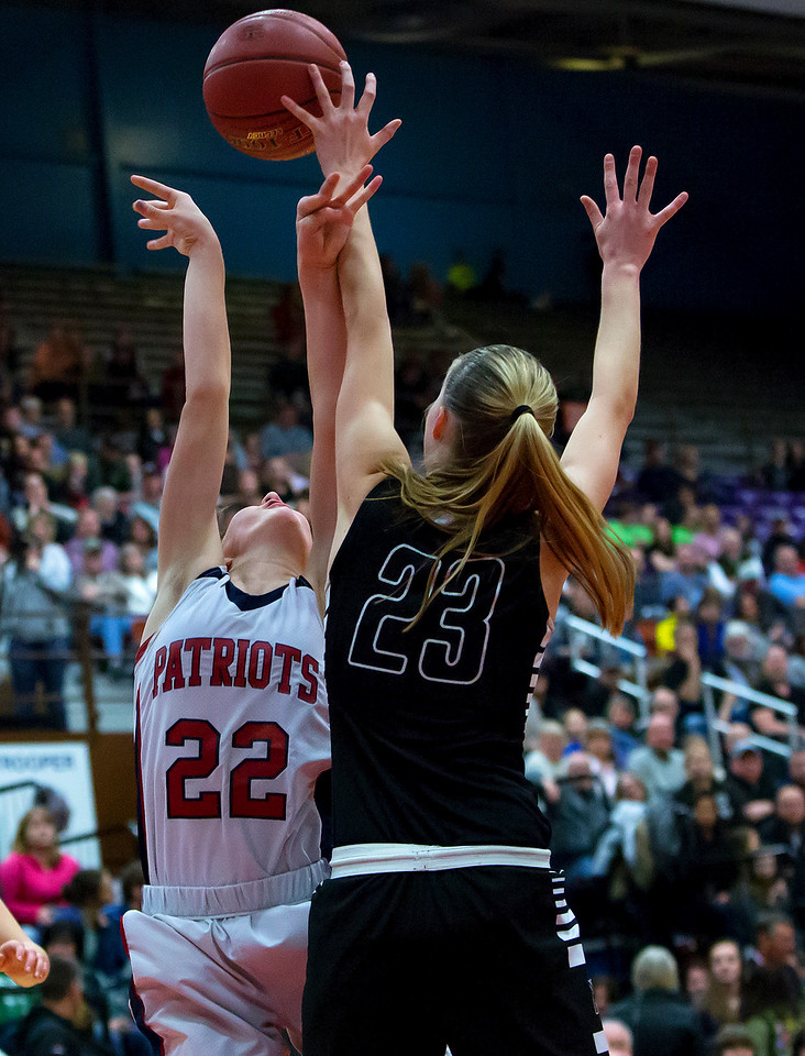 AUGUSTA, Maine -- 03/03/2017 -- Gray-New Gloucester's Jordan Grant (left) has her shot blocked by Houlton's Kolleen Bouchard during their Class B girls basketball state championship at the Augusta Civic Center in Augusta Friday. Ashley L. Conti   BDN