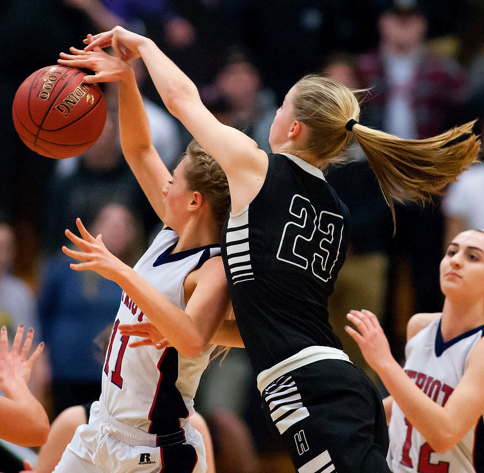AUGUSTA, Maine -- 03/03/2017 -- Gray-New Gloucester's Isabelle DeTroy (left) tries to win a rebound against Houlton's Kolleen Bouchard during their Class B girls basketball state championship at the Augusta Civic Center in Augusta Friday. Ashley L. Conti   BDN