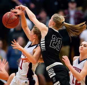 AUGUSTA, Maine -- 03/03/2017 -- Gray-New Gloucester's Isabelle DeTroy (left) tries to win a rebound against Houlton's Kolleen Bouchard during their Class B girls basketball state championship at the Augusta Civic Center in Augusta Friday. Ashley L. Conti | BDN