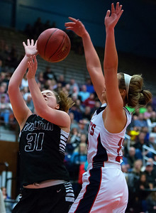 AUGUSTA, Maine -- 03/03/2017 -- Houlton's Emma Peterson (left) is fouled by Gray-New Gloucester's Alicia Dumont during their Class B girls basketball state championship at the Augusta Civic Center in Augusta Friday. Ashley L. Conti | BDN