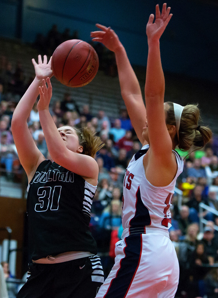AUGUSTA, Maine -- 03/03/2017 -- Houlton's Emma Peterson (left) is fouled by Gray-New Gloucester's Alicia Dumont during their Class B girls basketball state championship at the Augusta Civic Center in Augusta Friday. Ashley L. Conti   BDN