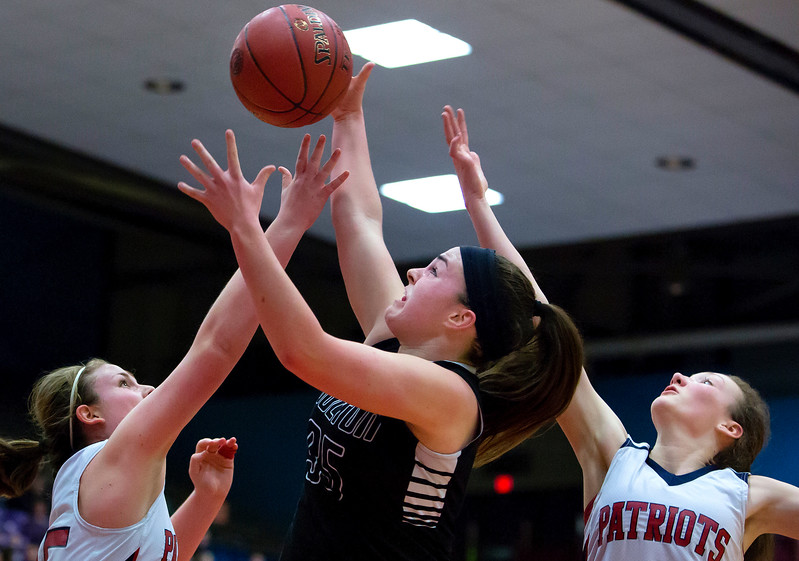 AUGUSTA, Maine -- 03/03/2017 -- Gray-New Gloucester's Skye Conley (left) and Houlton's Aspen Flewelling (center) battle for a rebound against Gray-New Gloucester's Jordan Grant during their Class B girls basketball state championship at the Augusta Civic Center in Augusta Friday. Ashley L. Conti | BDN