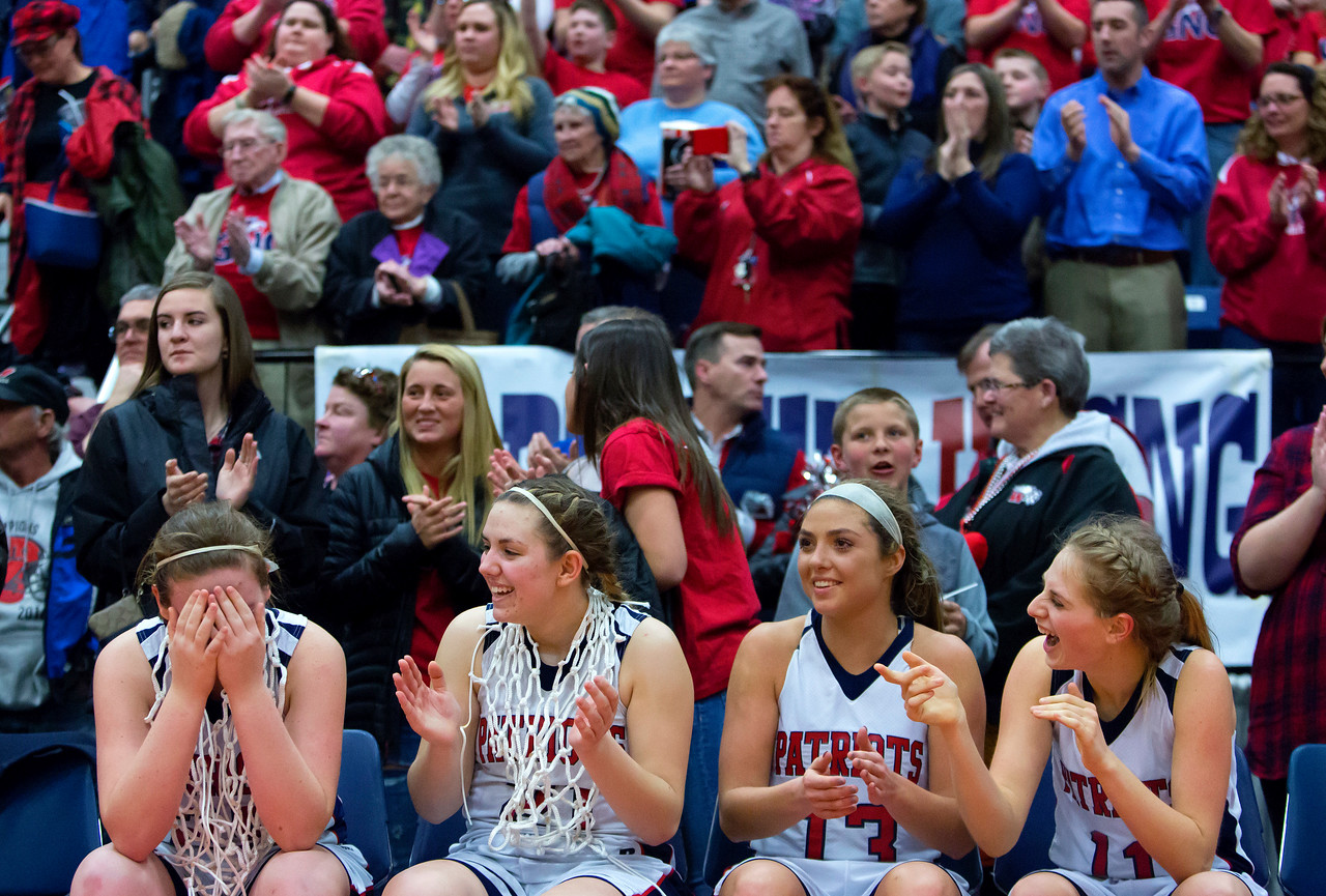 AUGUSTA, Maine -- 03/03/2017 -- Gray-New Gloucester's Skye Conley (left) covers her eyes after defeating Houlton during their Class B girls basketball state championship at the Augusta Civic Center in Augusta Friday. Ashley L. Conti   BDN