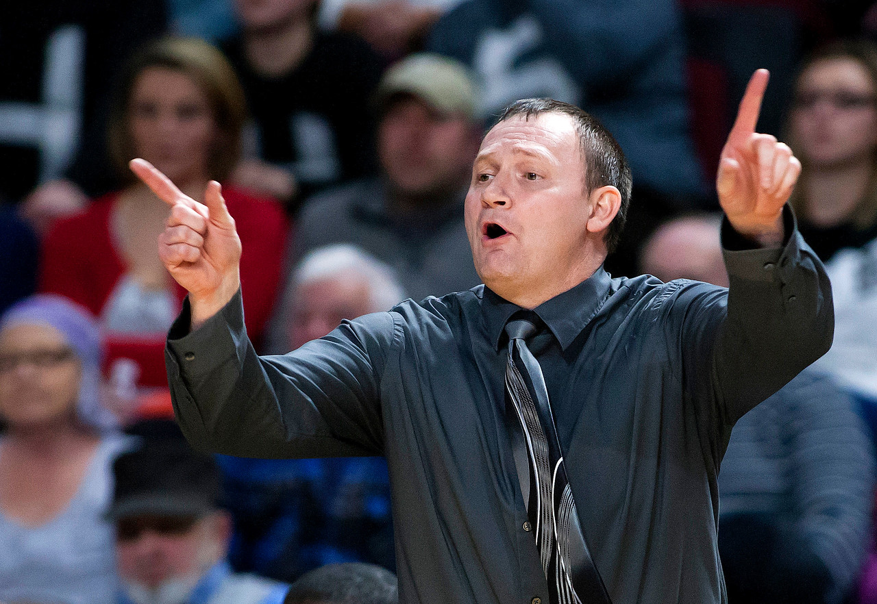 BANGOR, Maine -- 02/22/2017 -- Houlton head coach Shawn Graham yells instructions to his team during their Class B girls basketball semifinal game against Hermon at the Cross Insurance Center in Bangor Wednesday. Ashley L. Conti | BDN