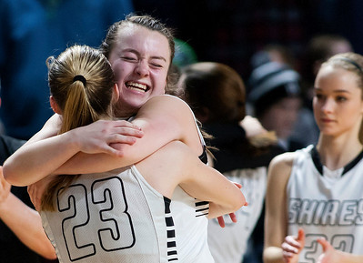 BANGOR, Maine -- 02/22/2017 -- Houlton's Kolleen Bouchard (left) celebrates with Abbie Worthley after defeating Hermon in over time during their Class B girls basketball semifinal game at the Cross Insurance Center in Bangor Wednesday. Ashley L. Conti | BDN