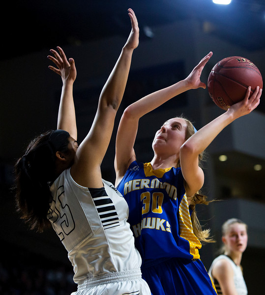 BANGOR, Maine -- 02/22/2017 -- Hermon's Lauren Plissey (right) goes up for two past Houlton's Tessa Solomon during their Class B girls basketball semifinal game at the Cross Insurance Center in Bangor Wednesday. Ashley L. Conti | BDN