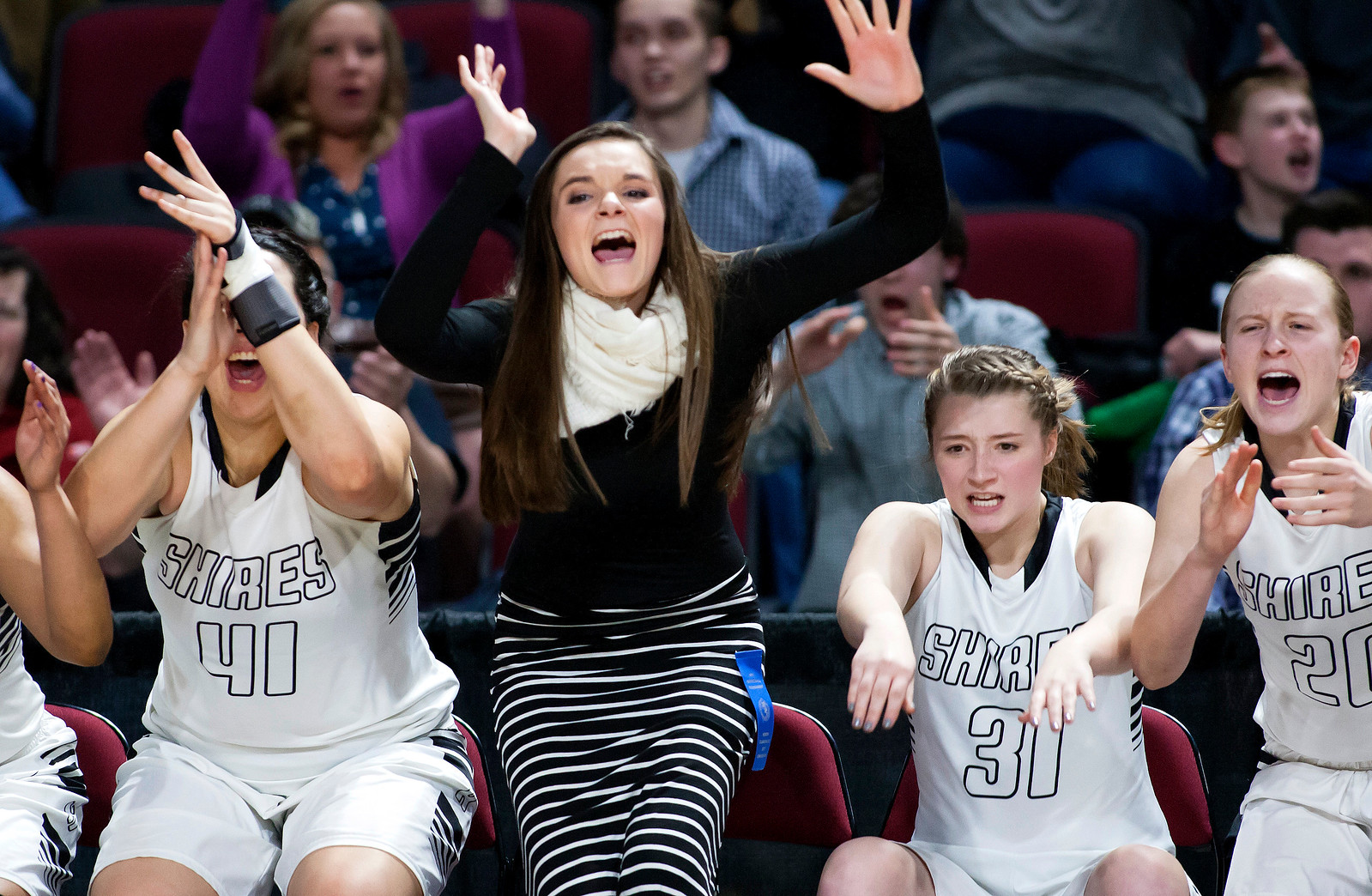 BANGOR, Maine -- 02/22/2017 -- Houlton celebrates as their team takes the lead during their Class B girls basketball semifinal game against Hermon at the Cross Insurance Center in Bangor Wednesday. Ashley L. Conti | BDN