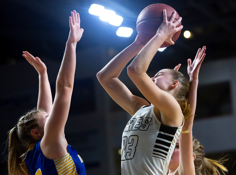 BANGOR, Maine -- 02/22/2017 -- Houlton's Kolleen Bouchard (right) puts up a shot past Hermon during their Class B girls basketball semifinal game at the Cross Insurance Center in Bangor Wednesday. Ashley L. Conti | BDN