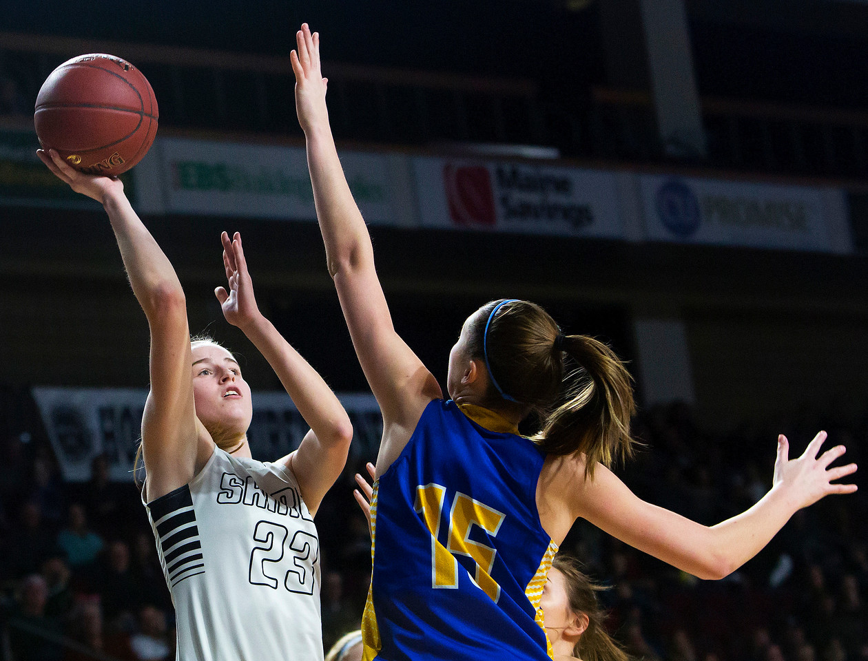 BANGOR, Maine -- 02/22/2017 -- Houlton's Kolleen Bouchard (left) puts up a shot past Hermon's Emi Higgins during their Class B girls basketball semifinal game at the Cross Insurance Center in Bangor Wednesday. Ashley L. Conti | BDN