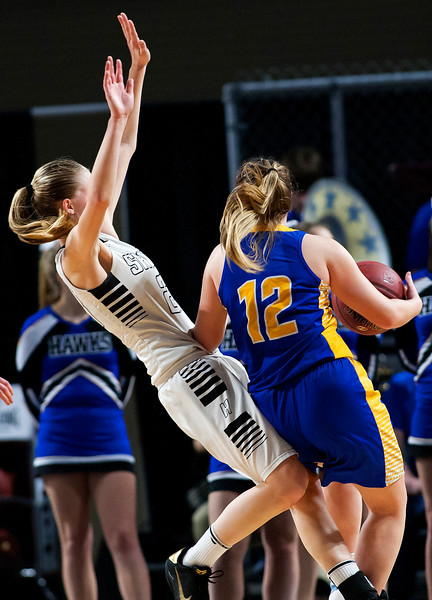 BANGOR, Maine -- 02/22/2017 -- Houlton's Kolleen Bouchard (left) is fouled by Hermon's Madisyn Curtis during their Class B girls basketball semifinal game at the Cross Insurance Center in Bangor Wednesday. Ashley L. Conti | BDN