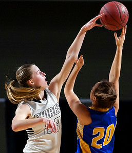 BANGOR, Maine -- 02/22/2017 -- Houlton's Kolleen Bouchard (left) blocks a shot by Hermon's Chloe Raymond during their Class B girls basketball semifinal game at the Cross Insurance Center in Bangor Wednesday. Ashley L. Conti | BDN