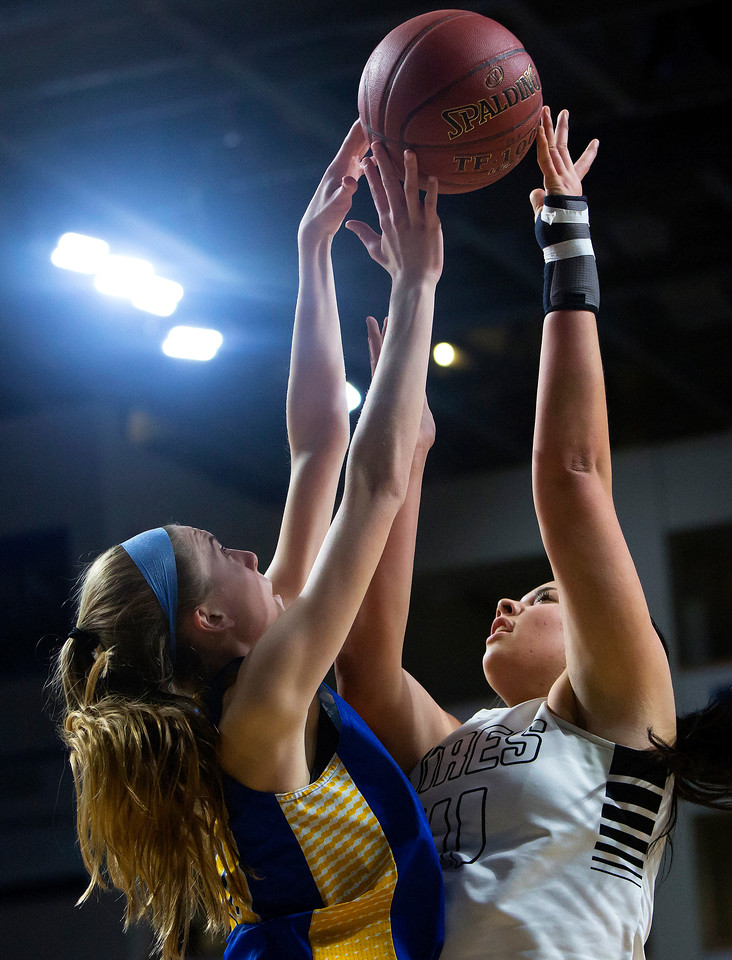 BANGOR, Maine -- 02/22/2017 -- Hermon's Lauren Plissey (left) battles for a rebound with Houlton's Makala Watson during their Class B girls basketball semifinal game at the Cross Insurance Center in Bangor Wednesday. Ashley L. Conti | BDN