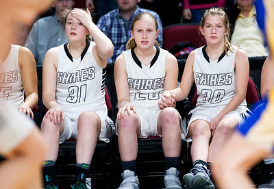 BANGOR, Maine -- 02/22/2017 -- Houlton's Emma Peterson (from left), Teagan Ewings and Jamie Brown anxiously watch their team during their Class B girls basketball semifinal game against Hermon at the Cross Insurance Center in Bangor Wednesday. Ashley L. Conti | BDN