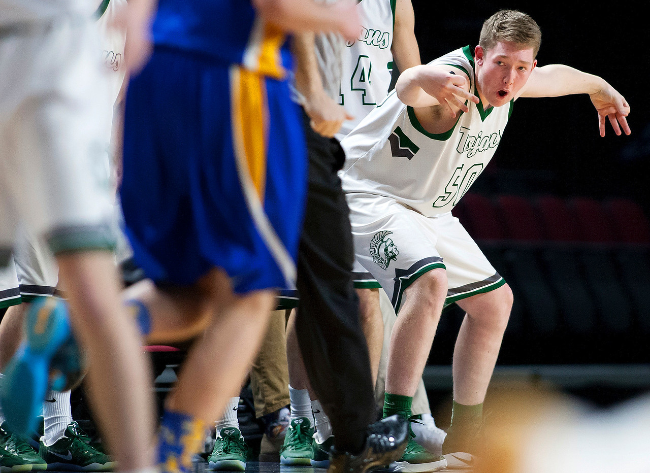 BANGOR, Maine -- 02/17/2017 -- Mount Desert Island's MacLean Shea celebrates after his teammate sunk a three pointer against Belfast during their Class B boys basketball quarterfinal game at the Cross Insurance Center in Bangor Friday. Ashley L. Conti   BDN