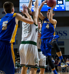 BANGOR, Maine -- 02/17/2017 -- Belfast's Stanley Sturgis (right) tries to fade a shot past Mount Desert Island's Riley Swanson during their Class B boys basketball quarterfinal game at the Cross Insurance Center in Bangor Friday. Ashley L. Conti | BDN