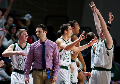 BANGOR, Maine -- 02/17/2017 -- Mount Desert Island celebrates after their team hit a three pointer against Belfast during their Class B boys basketball quarterfinal game at the Cross Insurance Center in Bangor Friday. Ashley L. Conti | BDN