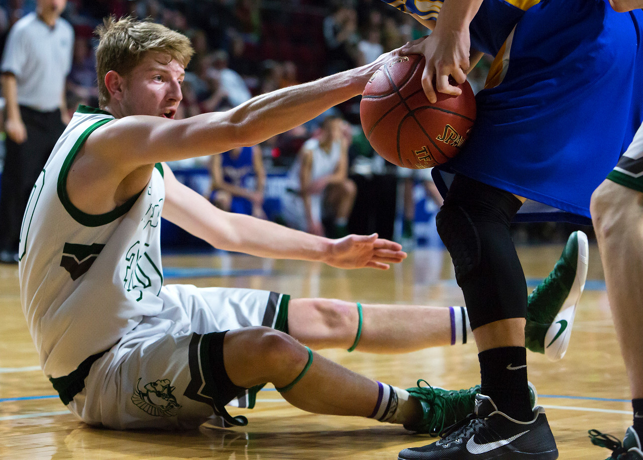BANGOR, Maine -- 02/17/2017 -- Mount Desert Island's Russell Kropff (left) tries to win a loose ball against Belfast's Dakota Doolan during their Class B boys basketball quarterfinal game at the Cross Insurance Center in Bangor Friday. Ashley L. Conti | BDN