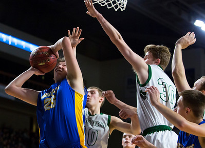 BANGOR, Maine -- 02/17/2017 -- Belfast's Ian Snowdeal (left) puts up a shot past Mount Desert Island's Russell Kropff during their Class B boys basketball quarterfinal game at the Cross Insurance Center in Bangor Friday. Ashley L. Conti | BDN