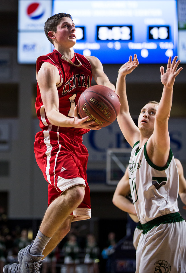 BANGOR, MAINE -- 02/22/2017 -- Central's Caleb M. Shaw jumps to shoot as Mount Desert Island's Riley Swanson tries to defend during their boys class B semifinal game at the Cross Insurance Center in Bangor on Wednesday afternoon. Micky Bedell   BDN