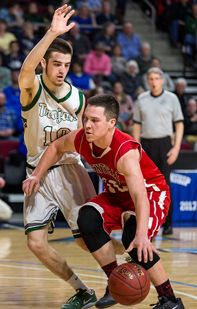 BANGOR, MAINE -- 02/22/2017 -- Central's Andrew W. Speed (right) tries to dribbles past Mount Desert Island's Andrew Phelps during their boys class B semifinal game at the Cross Insurance Center in Bangor on Wednesday afternoon. Micky Bedell | BDN