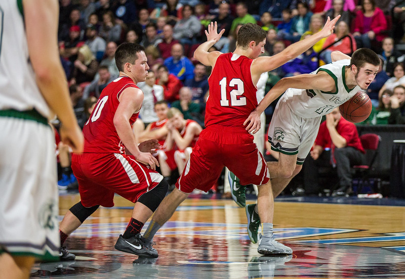 BANGOR, MAINE -- 02/22/2017 -- Mount Desert Island's Andrew Phelps leaps past Central defensemen Caleb M. Shaw (center) and Andrew W. Speed during their boys class B semifinal game at the Cross Insurance Center in Bangor on Wednesday afternoon. Micky Bedell | BDN