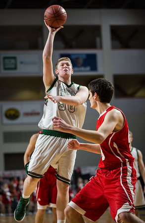 BANGOR, MAINE -- 02/22/2017 -- Mount Desert Island's MacLean Shea jumps to shoot past Central's Ethan P. Mailman during their boys class B semifinal game at the Cross Insurance Center in Bangor on Wednesday afternoon. Micky Bedell   BDN
