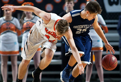 BANGOR, Maine -- 03/04/2017 -- Machias' James Mersereau (left) battles for a loose ball with Greenville's Connor DiAngelo during their Class D boys basketball state championship at the Cross Insurance Center in Bangor Saturday. Ashley L. Conti | BDN