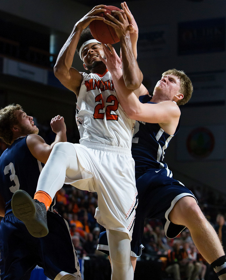 BANGOR, Maine -- 03/04/2017 -- Machias' Jacob Godfrey (left) battles for a rebound against Greenville's Devin W. Boone during their Class D boys basketball state championship at the Cross Insurance Center in Bangor Saturday. Ashley L. Conti   BDN