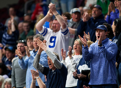 BANGOR, Maine -- 03/04/2017 -- Greenville fans cheer on their team during their Class D boys basketball state championship against Machias at the Cross Insurance Center in Bangor Saturday. Ashley L. Conti | BDN