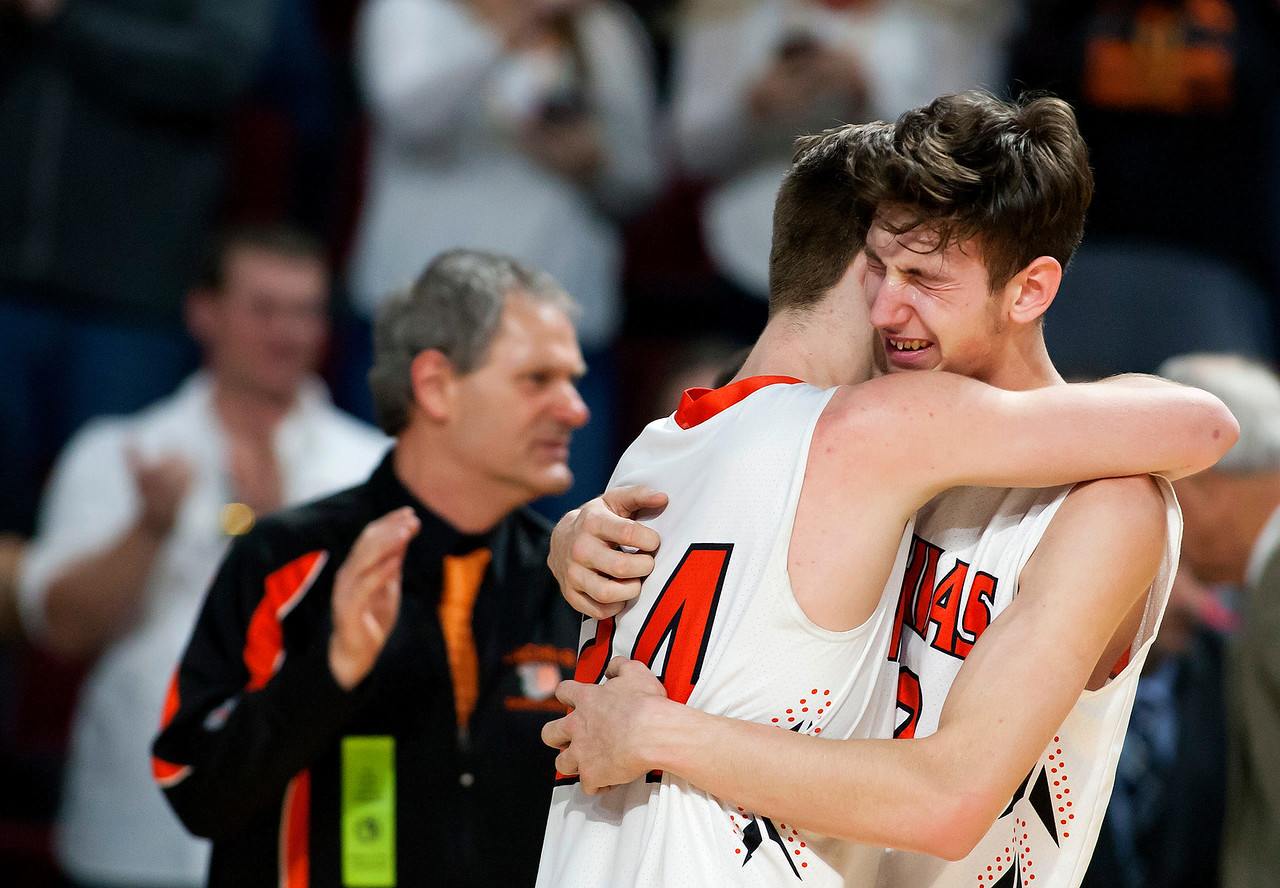 BANGOR, Maine -- 03/04/2017 -- Machias' James Mersereau (left) embraces Machias' Mark Anthony after defeating Greenville during their Class D boys basketball state championship at the Cross Insurance Center in Bangor Saturday. Ashley L. Conti | BDN