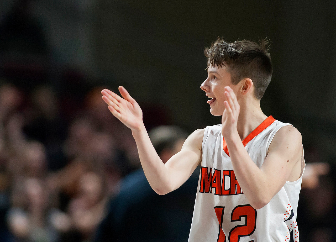BANGOR, Maine -- 03/04/2017 -- Machias' Camon Johnson turns and claps to Machias fans during their Class D boys basketball state championship against Greenville at the Cross Insurance Center in Bangor Saturday. Ashley L. Conti   BDN