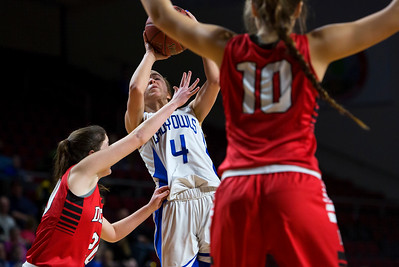 BANGOR, Maine -- 02/21/2017 -- Madawaska's Hannah Nadeau (center) puts up a shot past Dexter's Ashley Reynolds (left) and Dexter's Rebecca Batron during their Class C girls basketball quarterfinal game at the Cross Insurance Center in Bangor Tuesday. Ashley L. Conti | BDN