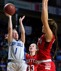 BANGOR, Maine -- 02/21/2017 -- Madawaska's Desiree Belanger (left) puts up a shot past Dexter's Abigail Webber (center) and Dexter's Rebecca Batron during their Class C girls basketball quarterfinal game at the Cross Insurance Center in Bangor Tuesday. Ashley L. Conti | BDN