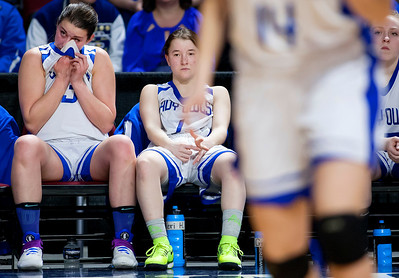 BANGOR, Maine -- 02/21/2017 -- Madawaska's Kathryn Bosse (left) wipes a tear from her eye while teammate Madawaska's Desiree Belanger sits dejected on the bench as time runs out during their Class C girls basketball quarterfinal game against Dexter at the Cross Insurance Center in Bangor Tuesday. Ashley L. Conti | BDN