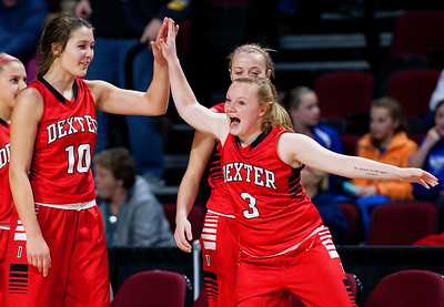 BANGOR, Maine -- 02/21/2017 -- Dexter's Cidney Pratt (right) high fives teammate Dexter's Rebecca Batron after defeating Madawaska during their Class C girls basketball quarterfinal game at the Cross Insurance Center in Bangor Tuesday. Ashley L. Conti | BDN