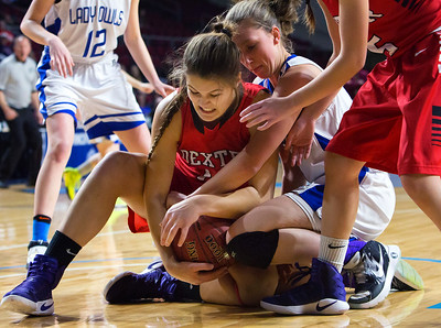 BANGOR, Maine -- 02/21/2017 -- Dexter's Rebecca Batron (left) battles for a loose ball with Madawaska's Cassidy Beaulieu during their Class C girls basketball quarterfinal game at the Cross Insurance Center in Bangor Tuesday. Ashley L. Conti | BDN