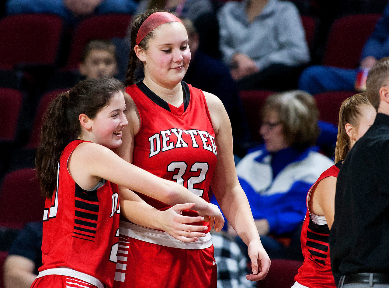 BANGOR, Maine -- 02/21/2017 -- Dexter's Ashley Reynolds (left) embraces teammate Megan Peach after realizing they will defeat Madawaska during their Class C girls basketball quarterfinal game at the Cross Insurance Center in Bangor Tuesday. Ashley L. Conti   BDN