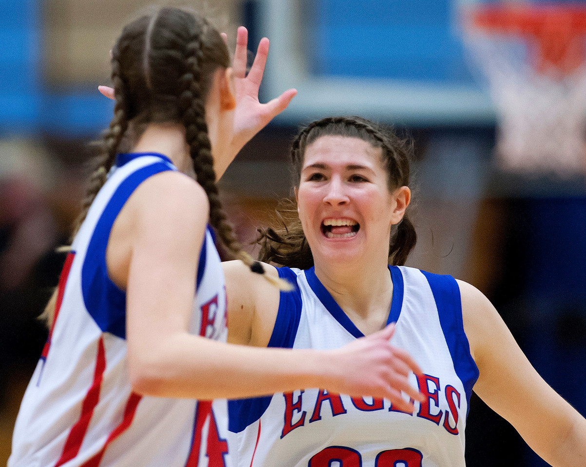 AUGUSTA, Maine -- 02/24/2017 -- Messalonskee's McKenna Brodeur (right) celebrates with her teammate Messalonskee's Gabrielle Wener after scoring against Nokomis during their Class A girls basketball championship game at the Augusta Civic Center in Augusta Friday. Ashley L. Conti | BDN