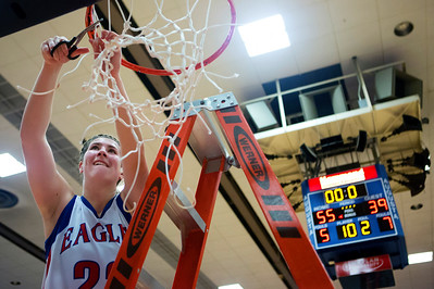AUGUSTA, Maine -- 02/24/2017 -- Messalonskee's McKenna Brodeur cuts down the net after defeating Nokomis during their Class A girls basketball championship game at the Augusta Civic Center in Augusta Friday. Ashley L. Conti | BDN