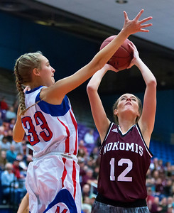 AUGUSTA, Maine -- 02/24/2017 -- Messalonskee's Sophia Holmes (left) blocks a shot from Nokomis' Olivia B. Brown during their Class A girls basketball championship game at the Augusta Civic Center in Augusta Friday. Ashley L. Conti | BDN