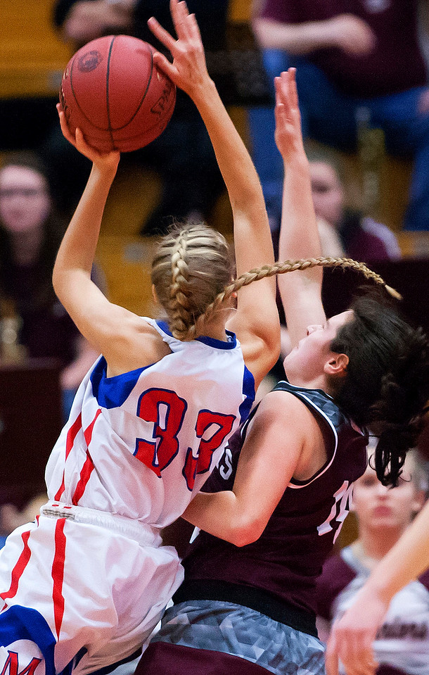 AUGUSTA, Maine -- 02/24/2017 -- Messalonskee's Allyssa Turner (left) is fouled by Nokomis' Chelsea J. Crockett during their Class A girls basketball championship game at the Augusta Civic Center in Augusta Friday. Ashley L. Conti | BDN