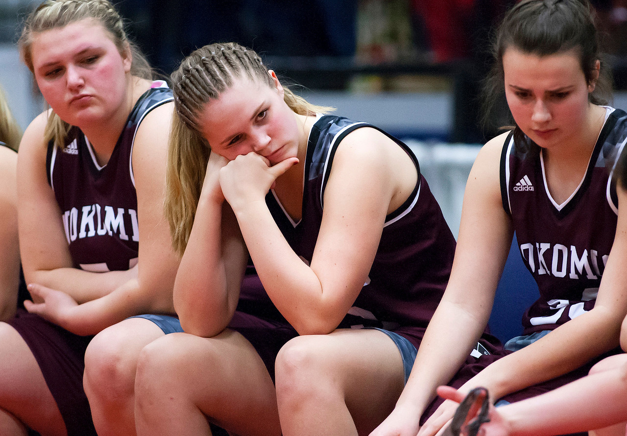 AUGUSTA, Maine -- 02/24/2017 -- Nokomis sits dejected after being defeated by Messalonskee during their Class A girls basketball championship game at the Augusta Civic Center in Augusta Friday. Ashley L. Conti   BDN