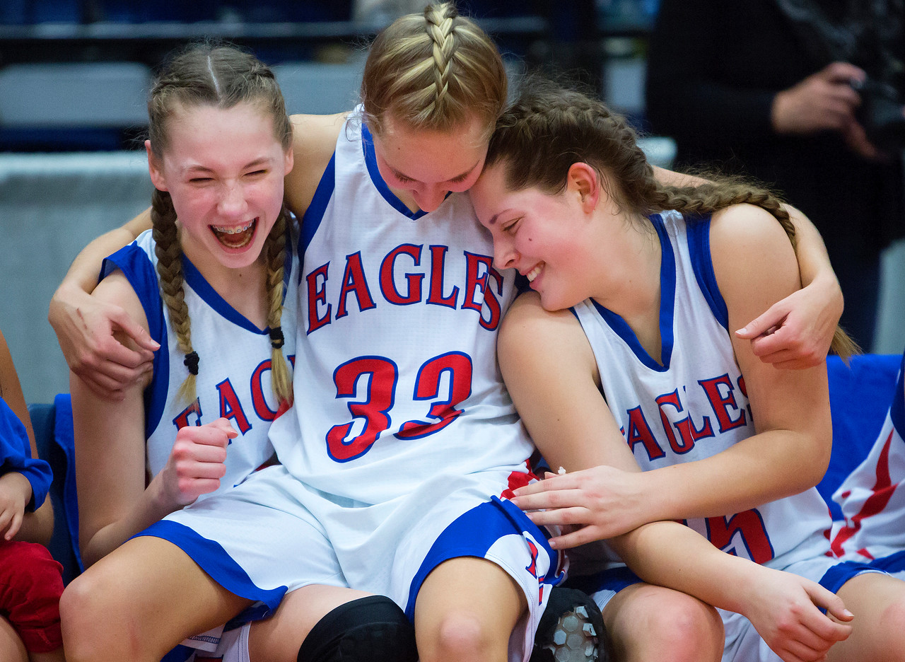 AUGUSTA, Maine -- 02/24/2017 -- Messalonskee's Gabrielle Wener (from left), Allyssa Turner, and Makayla Wilson celebrate after defeating Nokomis during their Class A girls basketball championship game at the Augusta Civic Center in Augusta Friday. Ashley L. Conti | BDN